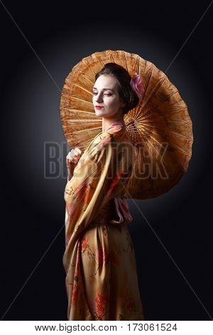 Beautiful Woman In Traditional Japanese Kimono With Umbrella