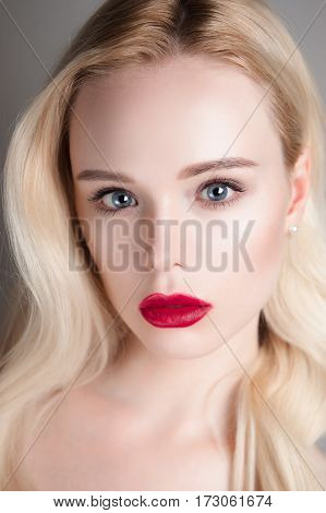 Beauty Model Girl With Perfect Make-up Red Lips And Blue Eyes Looking At Camera. Portrait Of Attract