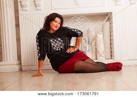 Beautiful brunette lying on floor
