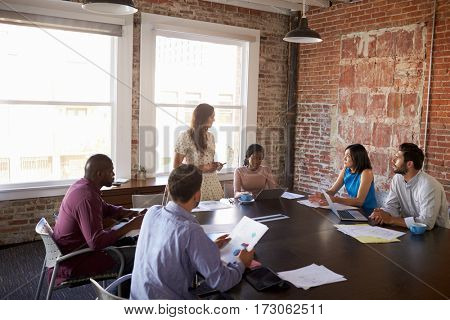 Businesswoman Standing To Address Boardroom Meeting