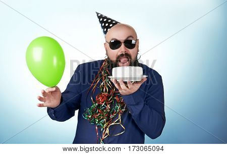 Funny fat man with birthday cake and balloon on color background
