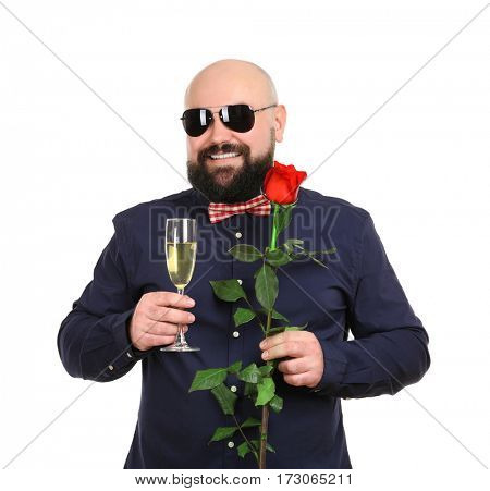 Bearded fat man with glass of champagne and flower on white background