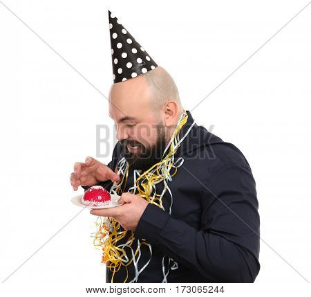 Funny fat man with tasty cake and party hat on white background