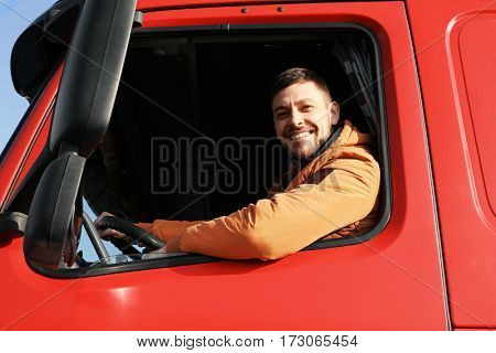 Male driver looking out of truck window