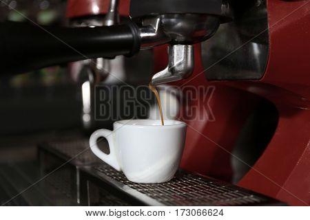 Coffee machine with cup, closeup
