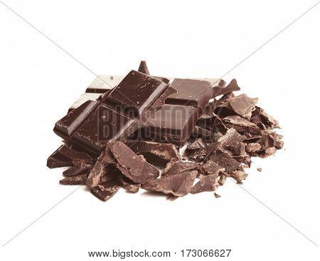 Broken dark chocolate pieces with morsels on white background
