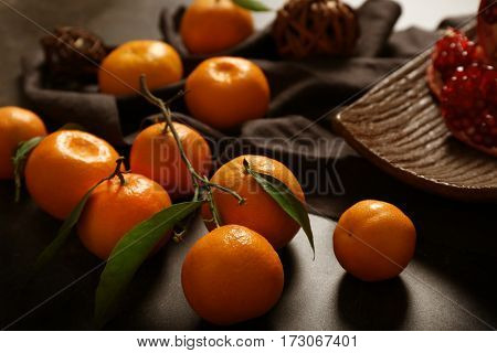 Composition of tangerine and garnet on gray table