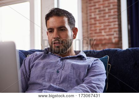Businessman Working On Sofa In Modern Creative Office