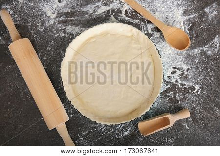 Cooking concept. Kitchen equipment and prepared dough on table