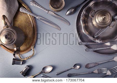 Set of vintage dinnerware on gray table