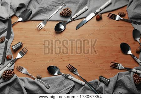 Cutlery set on wooden table