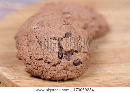 Brown Chocolate Biscuits On The Wooden Board