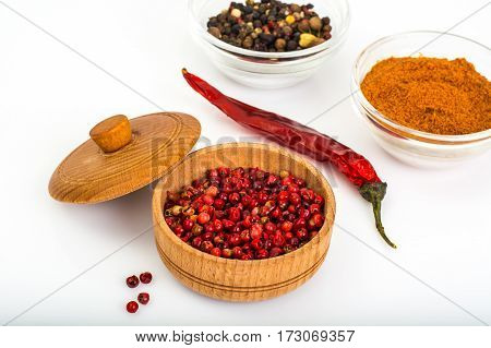 Spicy Spice Pink pepper peas on white background. Studio photo