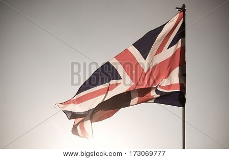 close up of Union Jack flag against blue sky