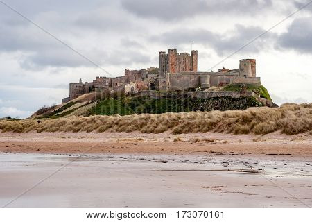 Bamburgh Castle is in Northumberland on the North East coast of England it is perched on a basalt outcrop overlooking the North Sea. Close to The Farne Islands & Holy Island: Bamburgh, Northumberland, England, UK. March 15 2016.