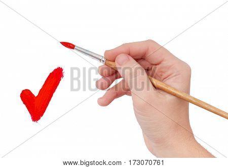 Female hand holding paint brush isolated over white background