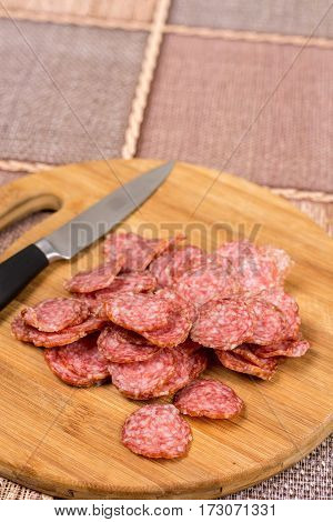 Flat Lay Overview Sliced Sausage On The Wooden Board