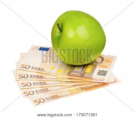 Green apple on heap of euro isolated on a white background
