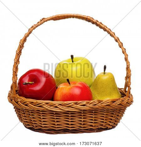 Artificial fruits in wicker basket isolated on white background