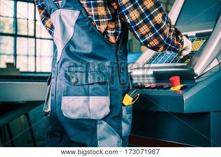 Production Machine Operator Closeup Photo. Factory Production Equipment.