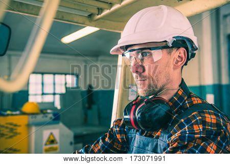 Production Worker in white helmet Portrait. Labor Concept.