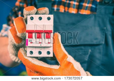 Production Line Worker Showing Electric Switcher Closeup Photo.