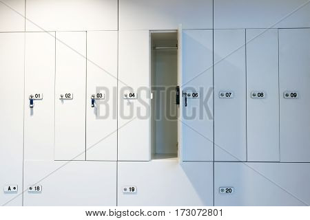 White locker with keys and different numbers