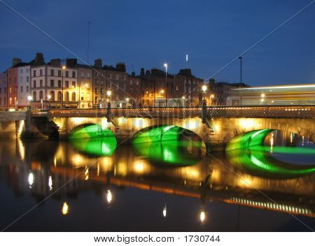 Night scene of a bridge over the river Liffey in Dublin poster