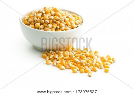 The corn seeds in bowl isolated on white background.