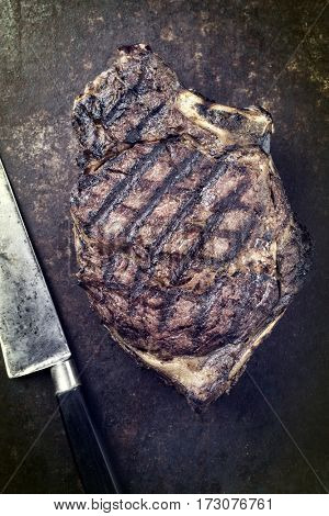 Barbecue dry aged Cote de Boef as close-up on an rusty sheet