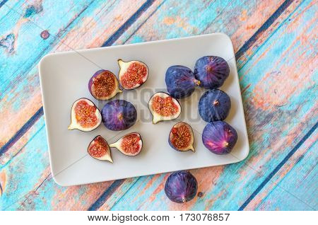 Purple Figs On Bright Plate
