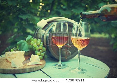 Pouring wine into glass on table