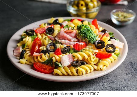 Cold pasta salad on table, closeup