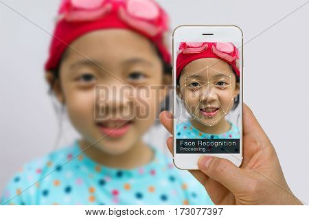 Concept of biometric verification face recognition technology using app on smartphone.