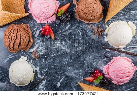 Selection of colorful ice cream scoops on marble background, copy space