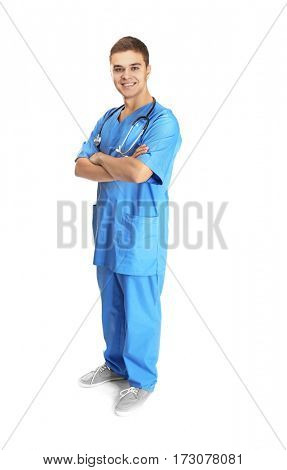 Young handsome doctor on white background