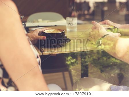 Mature couple drinking coffee together