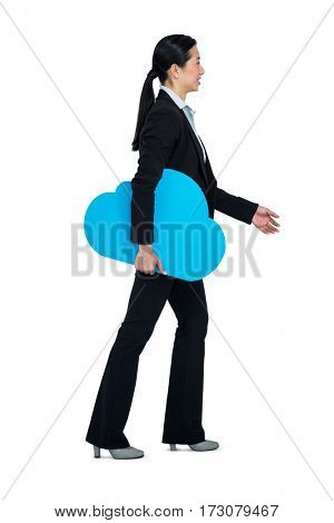 Smiling woman walking with cloud symbol against white background