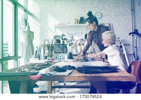 Fashion designer brainstorming and sharing ideas