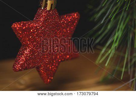 Close-up of christmas star hanging on christmas tree during christmas time