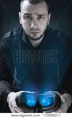 Portrait Of Businessman That Is Holding Glowing Virtual Reality Headset