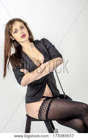 Attractive girl in a black jacket  posing coquettishly