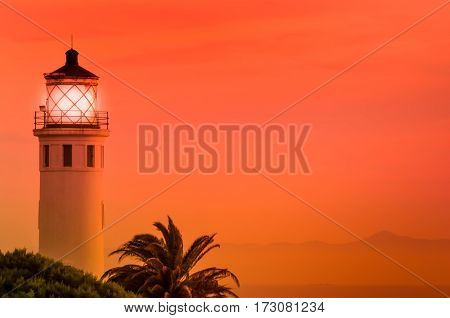 Point Fermin Lighthouse lit up at sunset