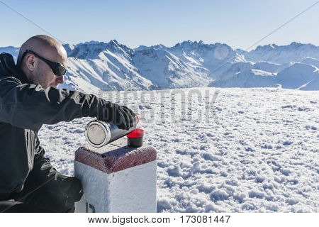 Tourist Pours Hot Tea In The Mountains.
