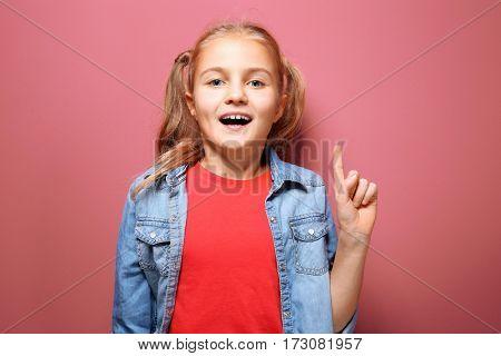 Emotional little girl on pink background
