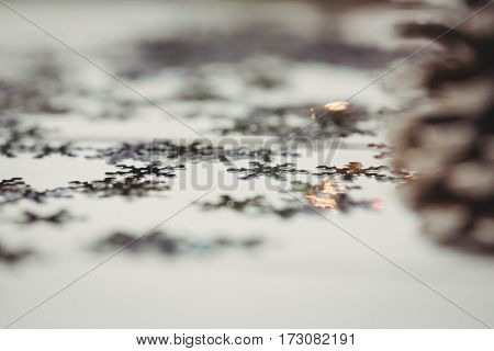 Pine cone and snowflake on wooden table during christmas time
