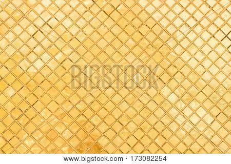golden pattern wall at grand palace, bangkok