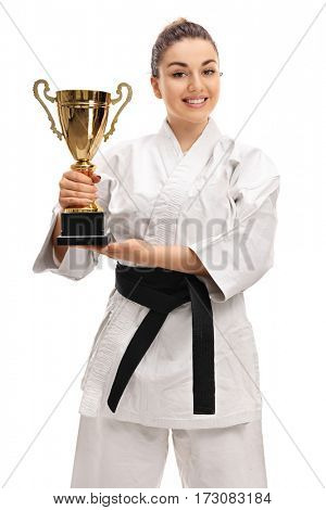 Joyful girl in a kimono holding a golden trophy isolated on white background