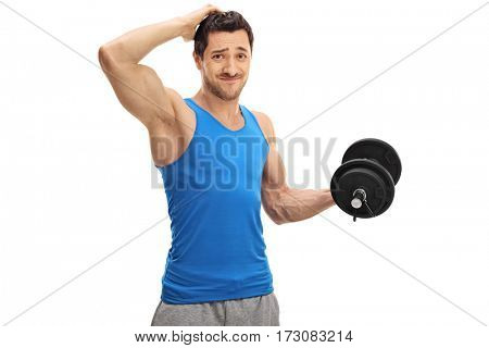 Tired guy lifting a dumbbell and holding his head isolated on white background