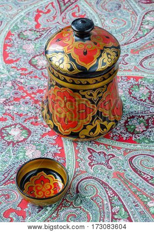 Russian Traditional Khokhloma Dishes On A Red Handkerchief